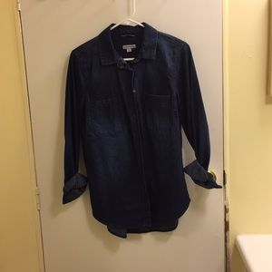Blue denim shirt in medium.
